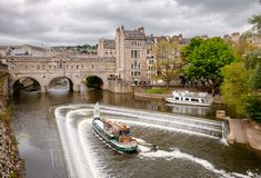 Palladian Pulteney Bridge and the weir at Bath Somerset South We. BATH, UK - JUN 11, 2013: City scene with weir on the River Avon near Palladian Pulteney Bridge Stock Photography