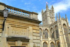 BATH, UK - JUNE 7, 2014: The entrance of the Roman Baths with the Abbey on the rightside Stock Photo