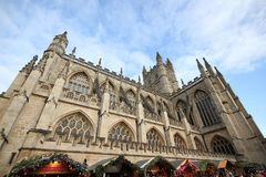 Bath, United Kingdom - December 6, 2013: Street view with The Ab. Bey Church of Saint Peter and Saint Paul, Bath, commonly known as Bath Abbey. Ordinary people Royalty Free Stock Images