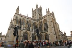Bath, United Kingdom - December 6, 2013: Street view with The Ab. Bey Church of Saint Peter and Saint Paul, Bath, commonly known as Bath Abbey. Ordinary people Stock Photography