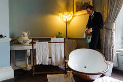Bath. Victorian butler preparing a bath. Scene of wax figure in royal bathroom. Warwick Castle, Warwickshire, England Stock Photography