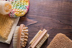Bath wisps loofah massagers on vintage wooden Royalty Free Stock Images
