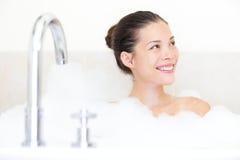 Bath woman. Enjoying bathtub with bath foam smiling happy. Mixed race Asian / Caucasian female model in bathroom Stock Images