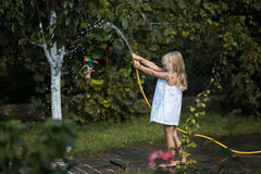 Bath in the yard(girl plays with water). Bath in the yard(garden stock photos