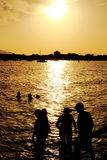 Bathe at sunset. A group of people bathe in the sea at sunset Royalty Free Stock Photos