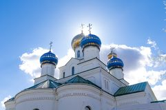 Bathed, crosses the church against the sky and the sun. Sacrament royalty free stock image