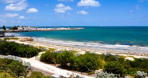 Bather's Beach: Fremantle, Western Australia. Bather's Beach on Fremantle's sandy foreshore with vegetated low dunes and path in Western Australia with turquoise Royalty Free Stock Photography