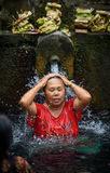 A Bather at the tirta empul fountains in bali 2 Royalty Free Stock Photography