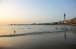 Bathers on the beach of Victoria at sunset, Costa de la Luz, Cadiz, Andalusia, Spain Stock Images