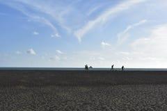 Bathers running on the beach. Iracema Beach, Ceara, Brasil stock photo