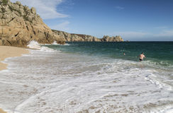 Bathers in the sea at Porthcurno beach in Cornwall Stock Photos