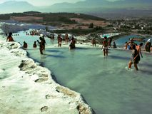 Bathers in the Thermal Pools at Pamukkale, Turkey. The hot water springs in Pamukkale (Turkish for cotton castle), is a unique natural site and tourist Royalty Free Stock Image