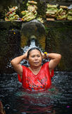 A Bathers at the tirta empul fountains in bali Stock Images
