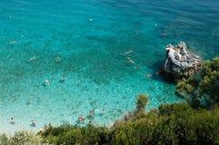 Bathers to the sea. Many bathers swim inside water like crystal of Mylopotamos, Greece Stock Photo