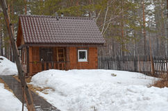 Bathhouse in the inner yard of country house. Spring sleet in the village. Siberia, Russia Stock Photo