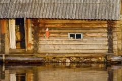 Bathhouse on lake. Woodet traditional bathowue on lake in sundown rays Royalty Free Stock Image