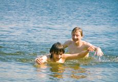 Bathing. Two lads bathe Royalty Free Stock Photo