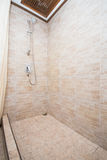 Bathing area in the bathroom with a shower Royalty Free Stock Image