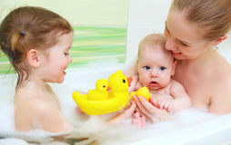 Bathing in  bath with foam mother together children baby Stock Image