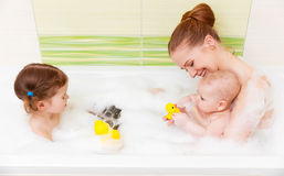 Bathing in bath with foam mother together children baby. Bathing in a bath with foam mother together children baby royalty free stock images