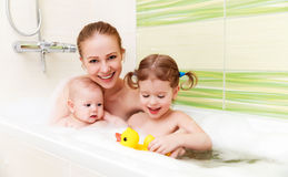 Bathing in bath with foam mother together children baby. Bathing in a bath with foam mother together children baby stock image