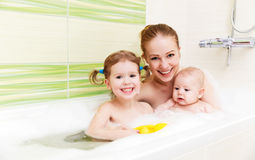 Bathing in bath with foam mother together children baby. Bathing in a bath with foam mother together children baby stock photos