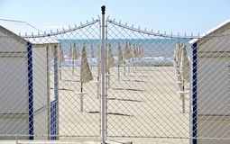 Bathing beach behind a wire fence Royalty Free Stock Images