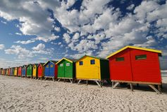 Bathing box clouds. Brightly coloured bathing boxes at Muizenberg beach, Cape Town Stock Photography
