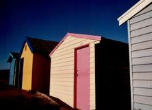 Bathing Boxes. A row of bathing boxes catch the morning sun at Safety Beach on the Mornington Peninsula, Victoria, Australia stock photo
