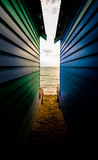 Between Bathing Boxes Royalty Free Stock Photography