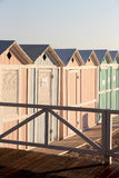 Bathing boxes and fence, early in the morning Stock Photography