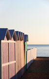Bathing boxes and fence at sunset, empty Stock Photo
