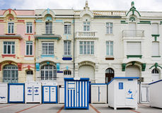 Bathing boxes in France. Blue and white bathing boxes in front of bourgeois building at Wimereux, North, France royalty free stock photos