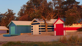Bathing boxes - rye,australia. A typical victorian beach scene in  late autumn sunshine Royalty Free Stock Images