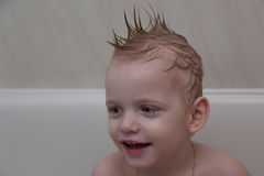 The bathing boy with a mohawk on the head Stock Images
