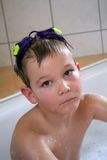 Bathing Child. A Child is playing in the bathtub Stock Images