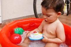Bathing child Stock Image