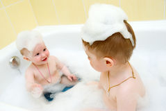 Bathing child..Small child in bath Royalty Free Stock Image