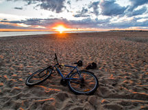 Bathing of a cyclist at sunset. In the Northern Dvina Royalty Free Stock Photo