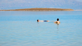 Bathing in the Dead Sea Royalty Free Stock Photos