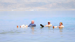 Bathing in the Dead Sea Royalty Free Stock Images
