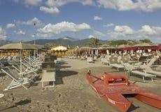 Bathing establishment in Marina di Massa. MARINA DI MASSA, ITALY - AUGUST 17 2015: Bathing establishment in Marina di Massa, with rowing life boat overlooking Royalty Free Stock Photo