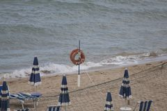Bathing establishment with umbrellas and deckchairs on the seashore.  royalty free stock photo