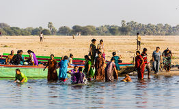 Bathing in the holy river. A group of women is taking a holy bath in the river Ganges Stock Photo