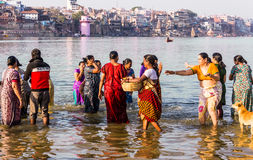 Bathing in the holy river. A group of women is taking a holy bath in the river Ganges Royalty Free Stock Photography