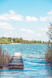 Bathing jetty Chiemsee. Bathing jetty for relaxing in light, green nature at Chiemsee, Germany Royalty Free Stock Images