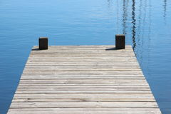 Bathing jetty and landing stage for boats with blue water Royalty Free Stock Image