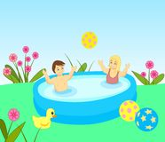 Bathing Kids. Two children playing with a ball Stock Image