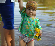 Bathing of little girl. Little girl bath in the river Royalty Free Stock Photography