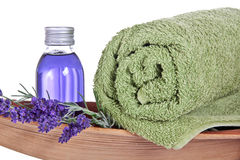 Bathing oil, lavender, towel. Lavender with oil flask, towel and coco leaf royalty free stock photos